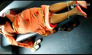 Desi beautiful Indian Aunty showing her beautiful legs from saree in train