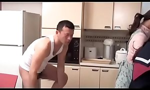 School girl wearing glass gets fucked by her step brother in the kitchen