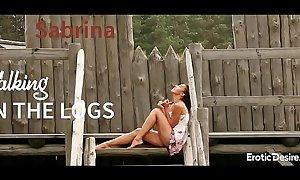 Sabrina - Walking on the logs. Visit Erotic desire.com to see full video.