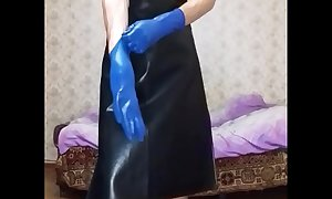 Guy in leather apron putting on different gloves