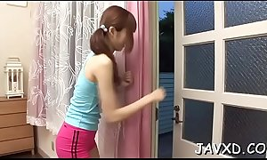 Sweetheart from asia is performing wonderful handjob and footjob