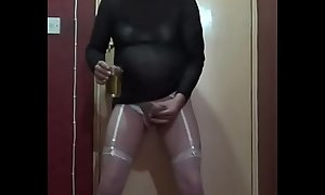 bisexual crossdressing sissy drinks his piss from a glass with cum in it