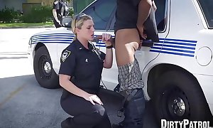 Busty police officers IR banged in the middle of the street