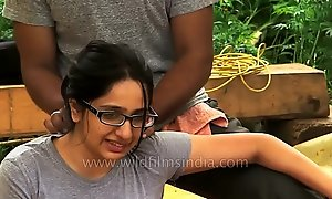 Woman receives therapeutic massage in Indian Himalaya.MP4