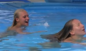 Two beautiful girls swimming and ribbons off out of one's mind the pool
