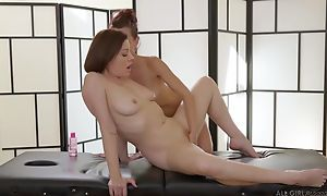 Two insatiable lesbians Hyperbolic sports jargon pulverize passionately during a massage