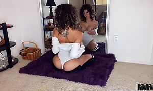 Curly-haired beauty with fine tits masturbates on the floor