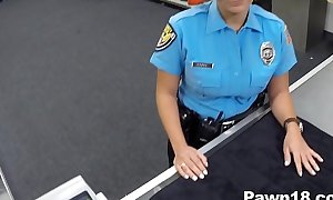 Policewoman comes secure pawn shop