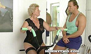 Horny granny bitch shamelessly takes gym traine...