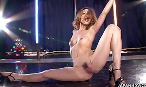 Asian stripper getting wild on the pole as this chick ...
