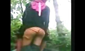 Indonesia- jilbab hijab dirty slut wife screwed by bf in a jungle