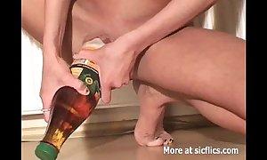 Skinny wench fucking giant bottles